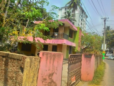 13.25 Cents of Commercial land with an old House for sale in Kozhikode.