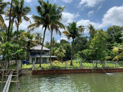52 Cents of Water Frontage Land with 900 SqFt House for sale at Puthenvelikara, Paravoor, Ernakulam